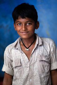 Boy in Bundi wearing a necklace with a significant number to Muslims, Rajasthan, India