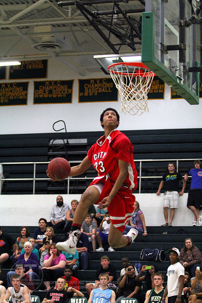 Iowa CIty High's Jerel Moore participates in the slam dunk competition. The Northern All-Star team defeated the Southern All-...