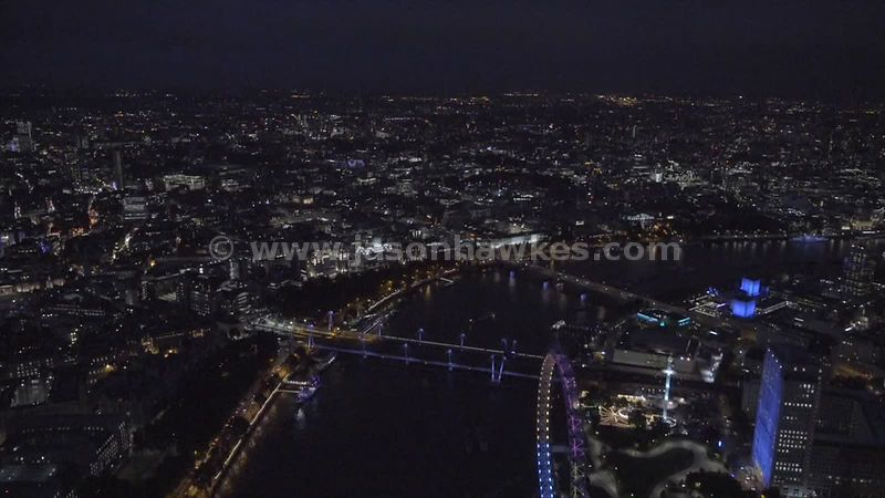 Aerial footage of the River Thames in Central London at night