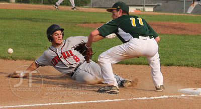 Iowa City West's Ezra Reiners attempts to tag out Linn-Mar's Wes Gaiser during play June 6, 2011.