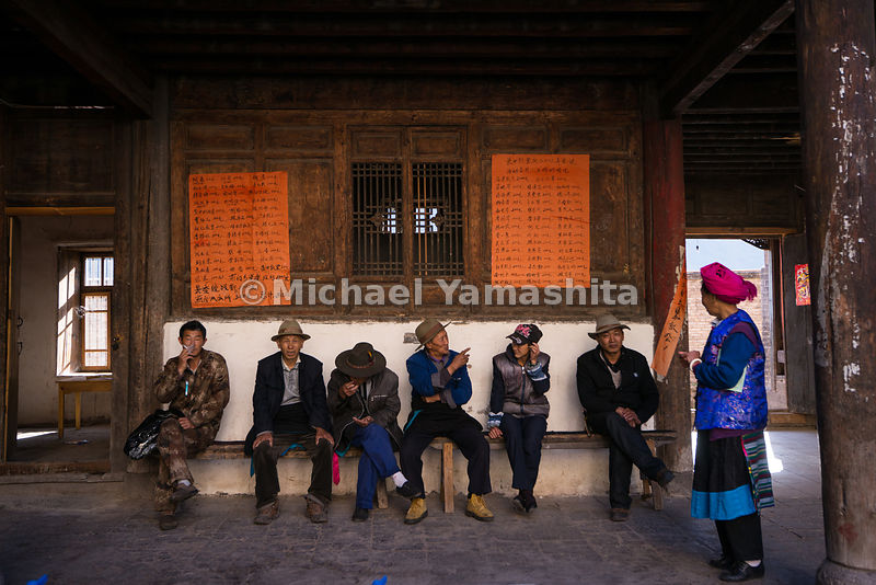 Residents catch up on news in Cizhong, a village known for its mix of Tibetan and French cultures. French missionaries built ...