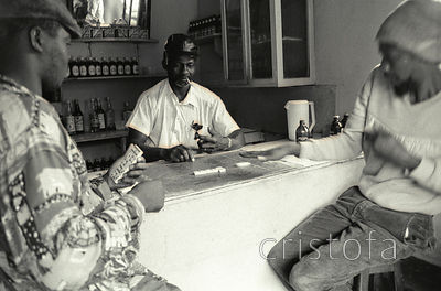men play dominoes in a bar at Hardware Gap in Jamaica