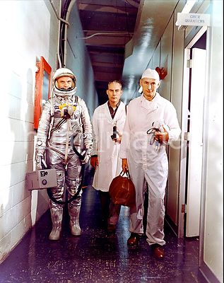 (1962) --- Astronaut John H. Glenn, Jr., Dr. William Douglas, astronauts Flight Surgeon, and equipment specialist Joe Schmitt...