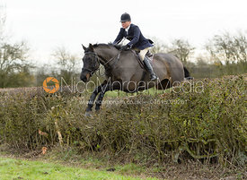 Nicky Hanbury jumping a hedge on Graham Smith's