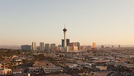 Medium SHot: Wide Shot: Sunset Over The Las Vegas Strip, Busy Streets, & Surrounding Neighborhood