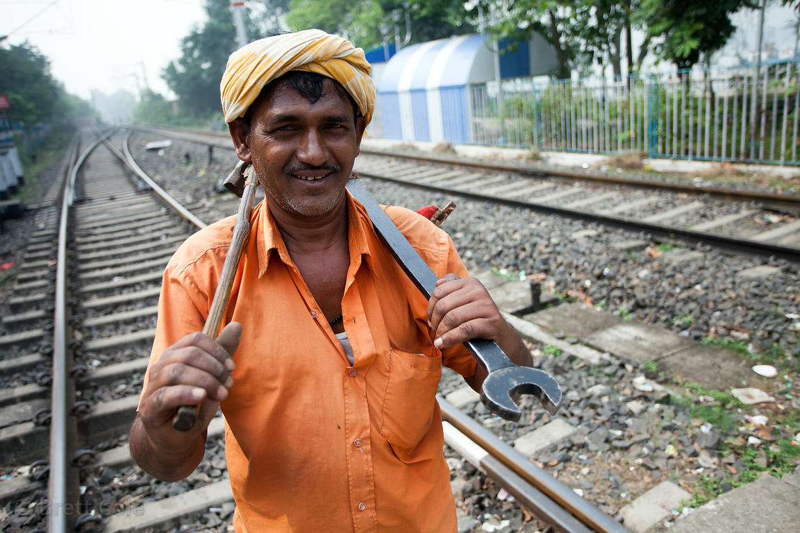 A railway mechanic walks the tracks near Princep Ghat