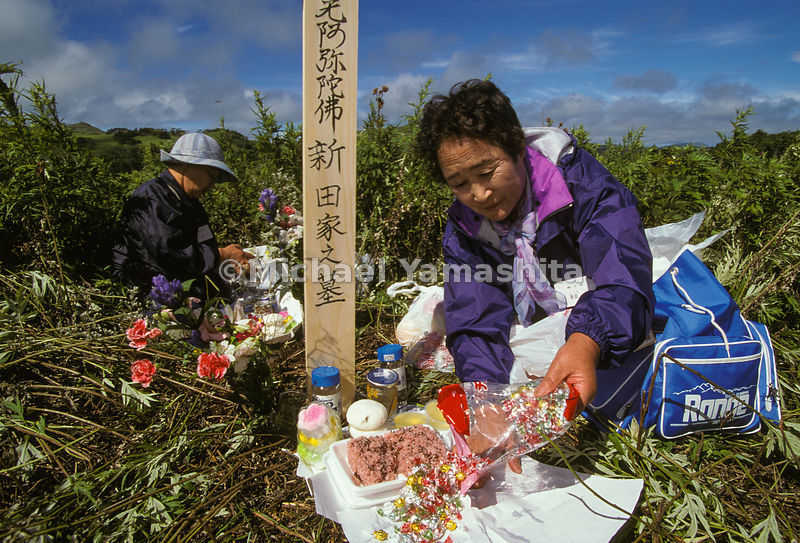 Japanese visiting graves...ancestors, candle, flowers, grave, japan, Kuril Islands, Kurils, mourning, National Geographic, of...