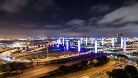 Wide Shot: Heavy Traffic, Wispy Clouds, & The 13 Neon Pylons of LAX