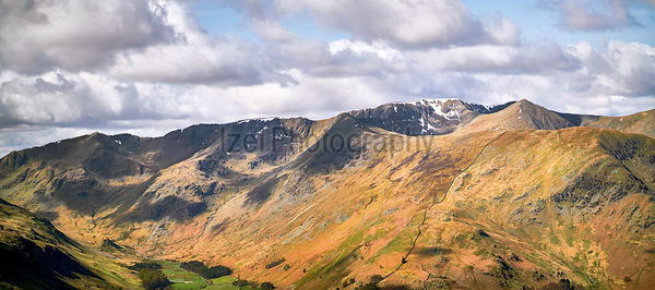 Views of Helvellyn, Striding & Swirral Edge and surrounding mountains above Glenridding in the Lake District, UK.