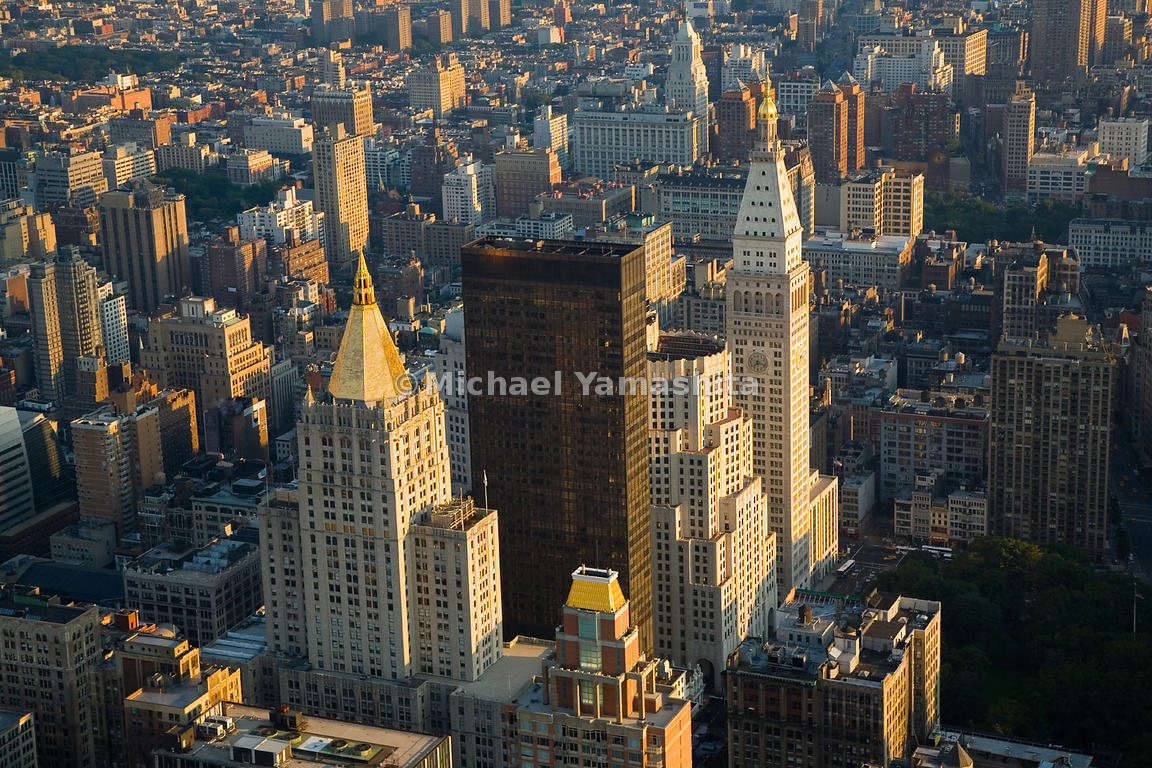 The gold-spired New York Life Building and the clocktower of the Metropolitan Life Insurance Building, modeled after the camp...