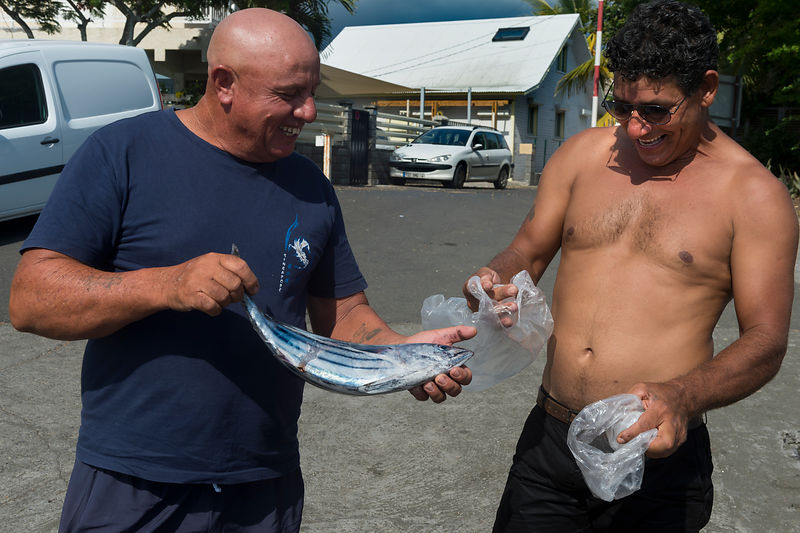 Fishermen with catch of bonito, St Leu harbour.