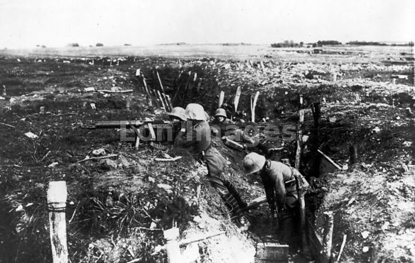 German machine gunners man trench during WWI
