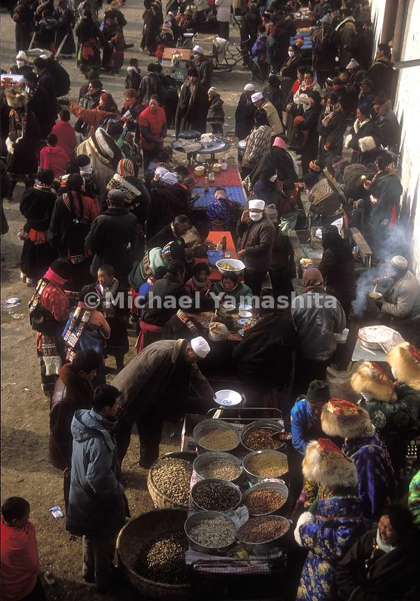 Outside the monastery, many food stands sell sunflower seed, soya beans and noodles.