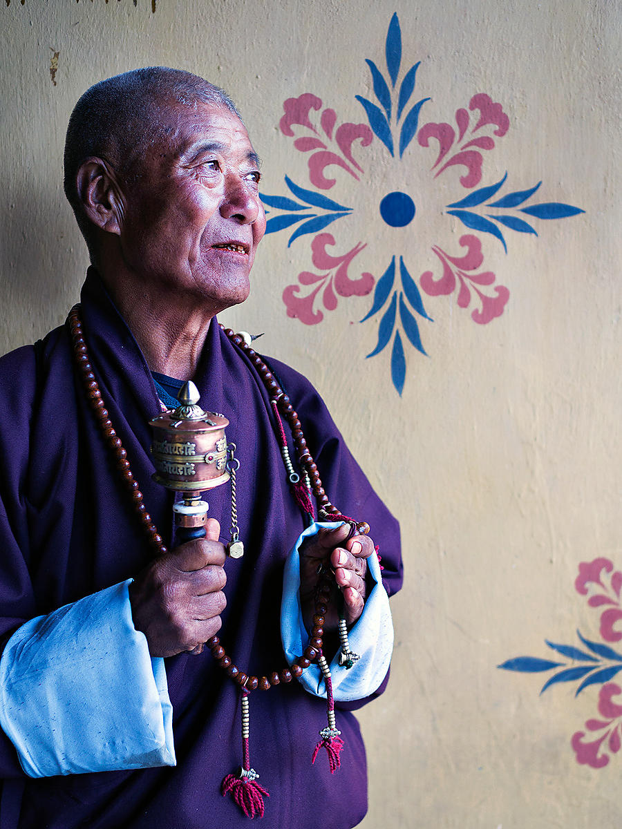 This photograph of an old monk chanting and praying was shot in a monastery in Bhutan.