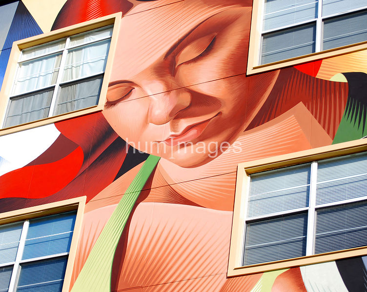 Large woman mural on apartment building in Dallas, Texas