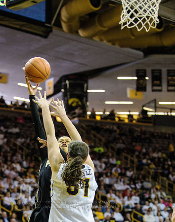 Purdue's Ashley Morrissette (1) puts up a jump shot as Iowa's Bethany Doolittle (51) defends during the first half of play at...