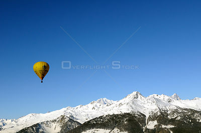 "Hot air balloon in flight over the Aosta Valley region of the northern Italian Alps. This is the ""Roof of Europe"": Mont Blanc..."