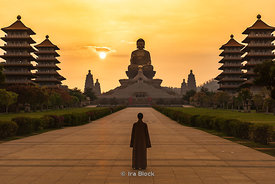 A nun stands in front of the Buddha statue at the Fo Guang Shan Buddha Museum in Dashu District, Kaohsiung, Taiwan