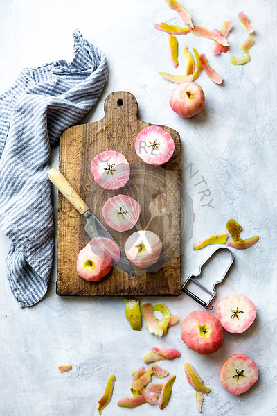 Chopped pink apples on a chopping board