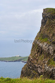 Looking down onto Neist Point lighthouse  from Ramasaig cliffs near Dunvegan on the Isle of Skye, Scotland, UK.
