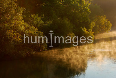 Steam coming off of a calm Trinity River in Texas