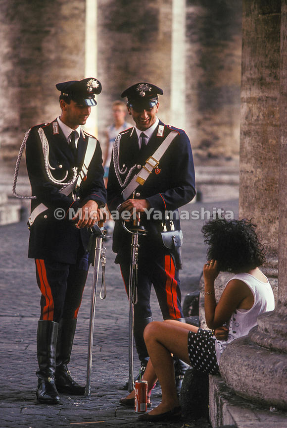 Two members of the Carabinieri speaking with a women in Saint Peter's Square.