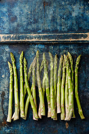 Fresh raw Green asparagus on blue wooden background copy space
