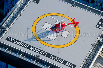 Aerial view of rooftop helipad and helicopter