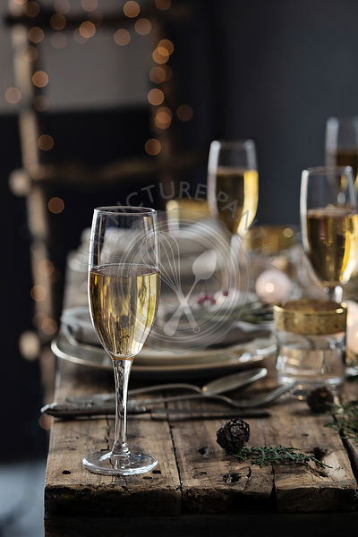 Holiday celebration table setting. Champagne glasses on christmas table setting