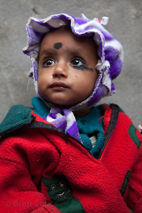 Portrait of a toddler in the Fakir Bagan neigborhood of Howrah, India, in an area served by the NGO Calcutta Kids (calcuttaki...