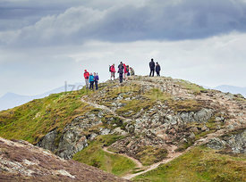 CAUSEY PIKE, ENGLAND, UK - MAY 06, 2016: A group of hikers on the summit of Causey Pike North West England.