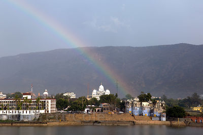 Rainbow over Pushkar Lake and the Gurudwara Singh Sabha Sikh temple, Pushkar, Rajasthan, India