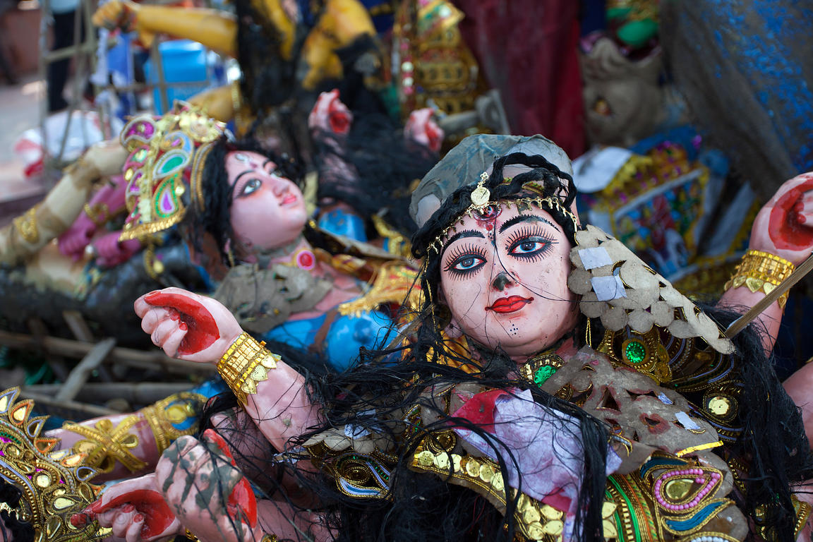 Durga Puja idols sits in piles at Babughat in Kolkata, India. The idols are statues of Hindu gods and goddesses that are brou...