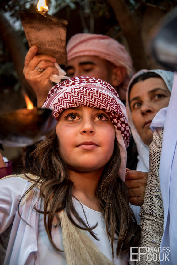 A young Yazidi girl celebrating Sere Sal, or Yazidi New Year in the temple courtyard at Lalish. Iraqi Kurdistan, 18th April, ...