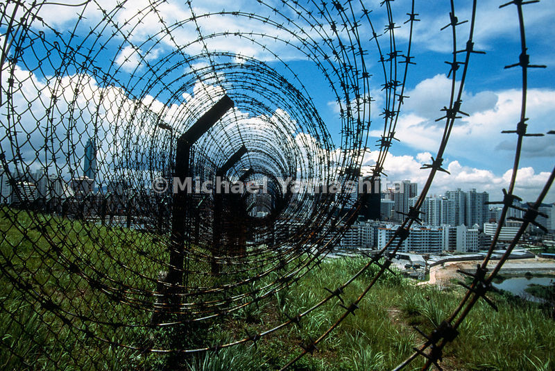 Even as the buildings of Shenzhen grow higher, the most imposing structure for many residents is the prickly wire border that...