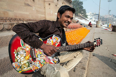 A man plays guitar on the ghats, Varanasi, India.