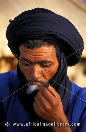 Tuareg smoking his pipe in the Sahara desert, Timbuktu, Mali