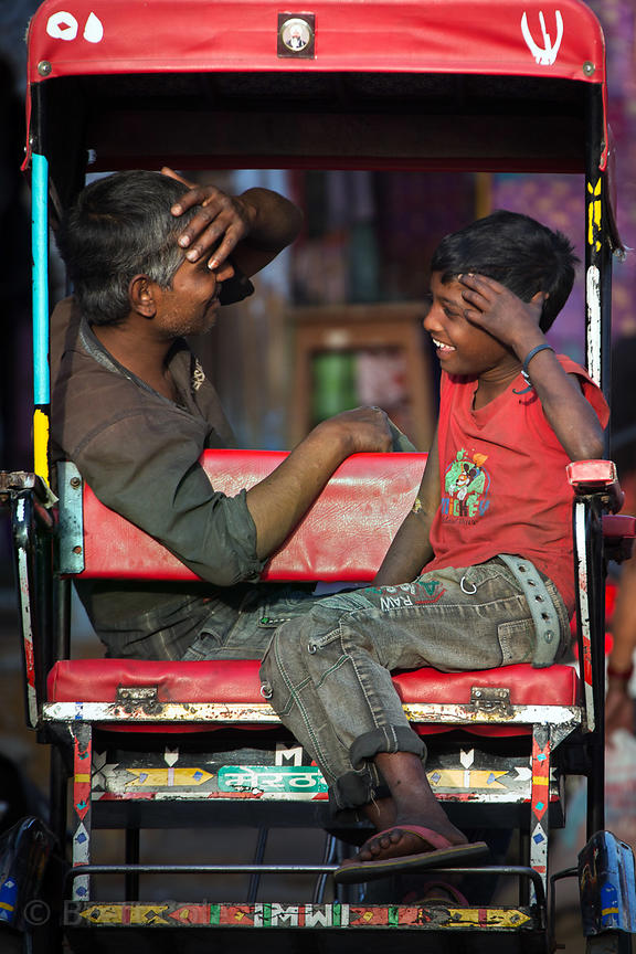 A rickshaw driver shares a moment with his son, Pushkar, Rajasthan, India