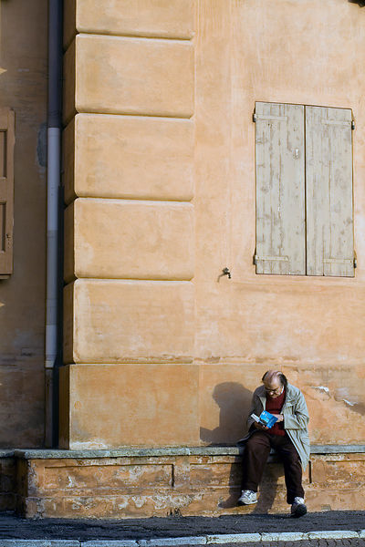 Italy - Bologna - A man reads in the afternoon sun, Santuario della Madonna di Santa Luca