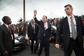 United Nations Secretary-General Ban Ki-Moon (C) waves as he arrives to visit a local Malagasy Non Governamental Organization...