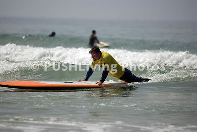 Man with a disability surfing
