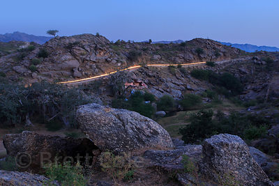 Light trail from a passing tractor before sunrise at the 7th century Ajaypal temple, near Pushkar, Rajasthan, India