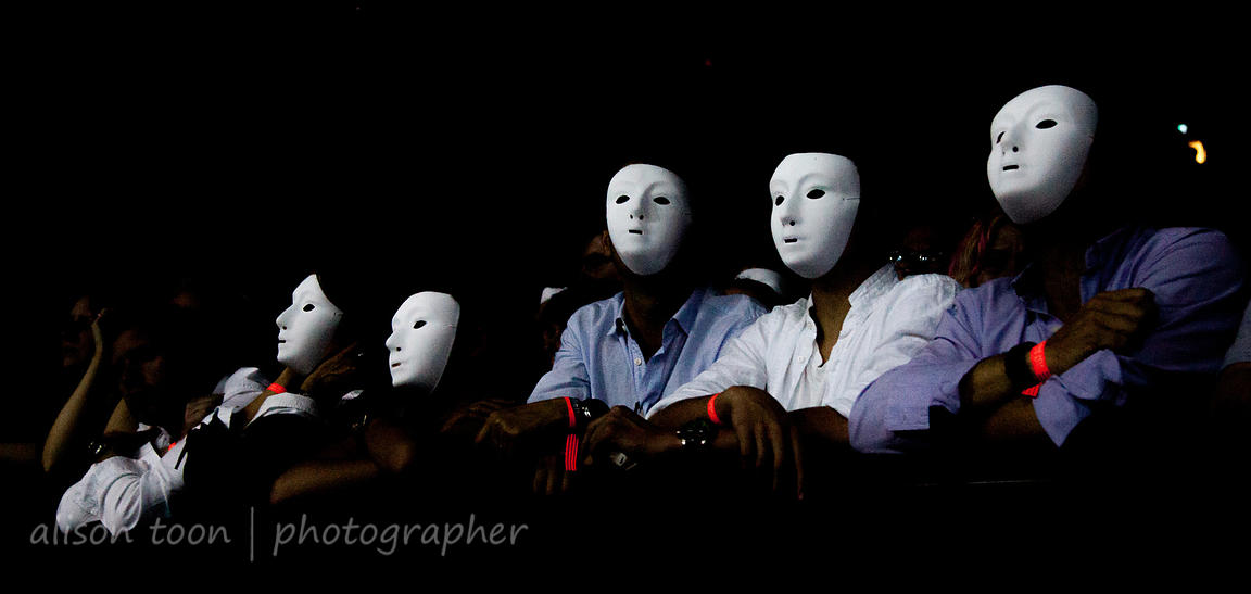 Audience wearing masks during Hollow Man, UK Marillion weekend, 2013