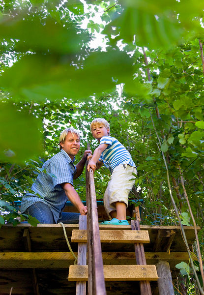 Father and son building treehouse