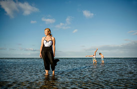 Young Nordic woman and children in the water 2