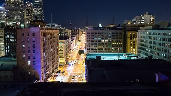 Bird's Eye: Poolside Rooftop Above Gold Lights of Broadway