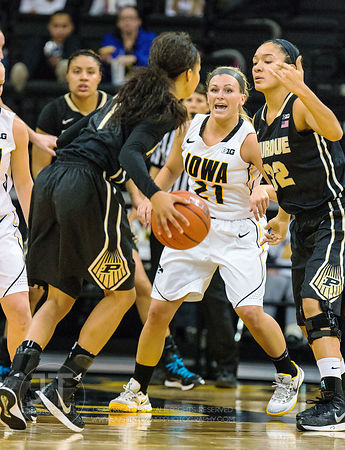 Iowa's Melissa Dixon (21) guards Purdue's Ashley Morrissette (1) and Whitney Bays (32) during the first half of play at Carve...