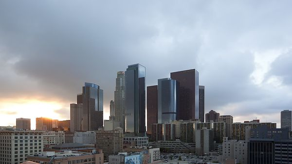 Medium Shot: Chaotic Cloud Decks & A Peaking Sunset Over Downtown L.A.
