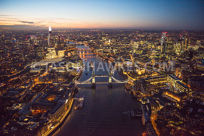 Aerial view of London at night The Shard with City of London skyline.