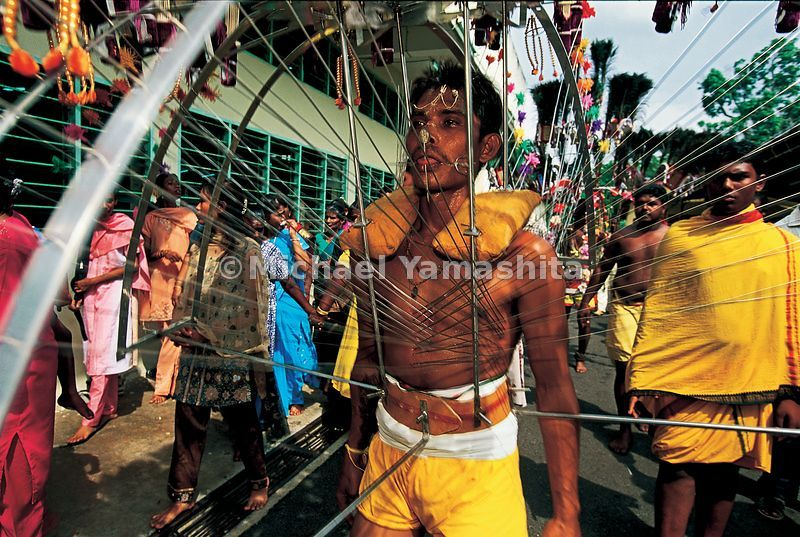In the most extreme form of body piercing, a Malaccan kavadi bearer wears this cage of spikes and fishhooks as reparation for...